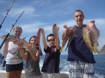 Nice Catch - Pescadores satisfechos en el barco Cavalier Pesca Deportiva Cavalier & Blue Marlin Gran Canaria