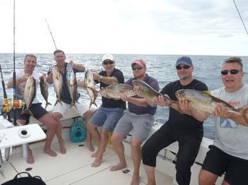 Great Catch - Pescadores satisfechos a bordo del barco Cavalier Pesca Deportiva Cavalier & Blue Marlin Gran Canaria